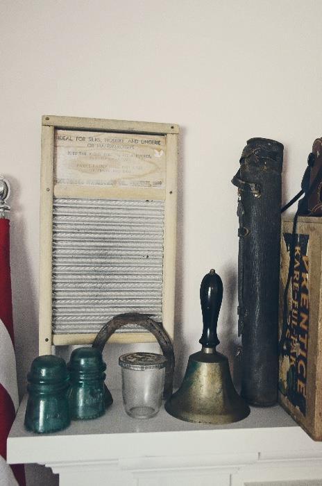 Washboard, glass insulator, horseshoe, school bell