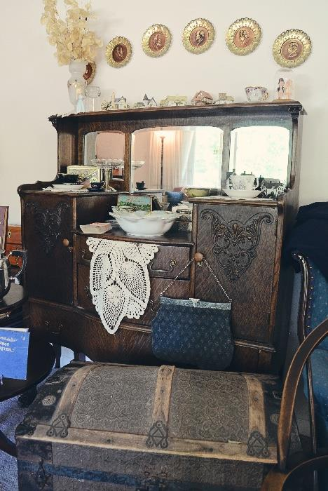 Antique 3-panel mirror sideboard, antique trunk, gate mouth clutch purse, R S Prussia bowl with boat, castle, & cliff motif