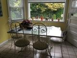 White glass top table with 6 iron chairs