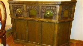 Carved Oak Bar. Moveable. Lighted Cabinet for hooch and barware storage.