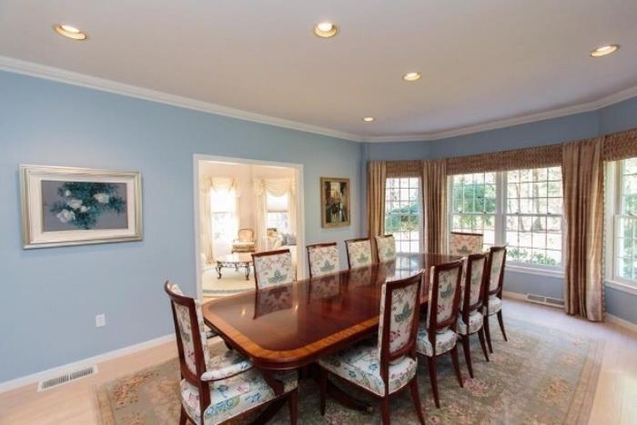 Fabulous Sudbury home features Double Pedestal, flame mahogany Dining Table from Mill House Antiques in CT.