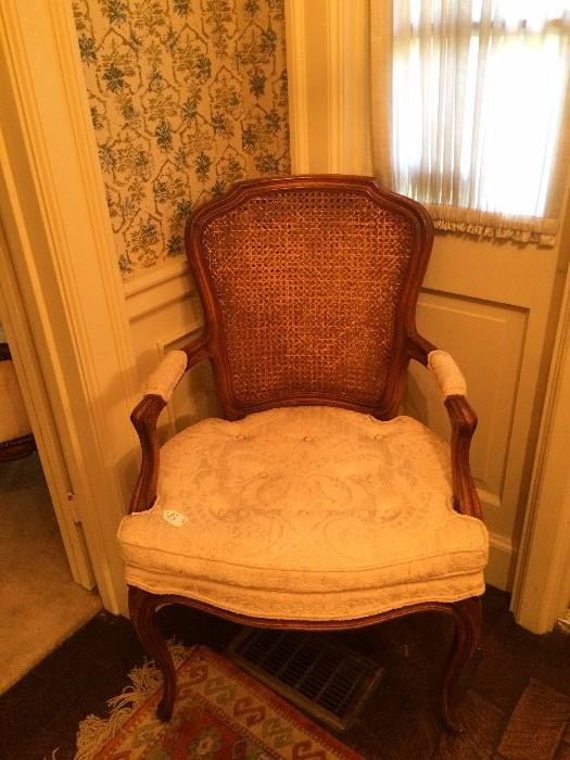 One of two cane chairs