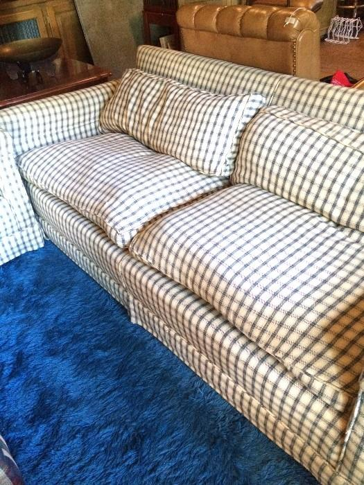 One of two checked sofas
