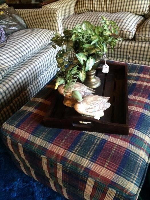 Plaid ottoman goes to two club chairs.