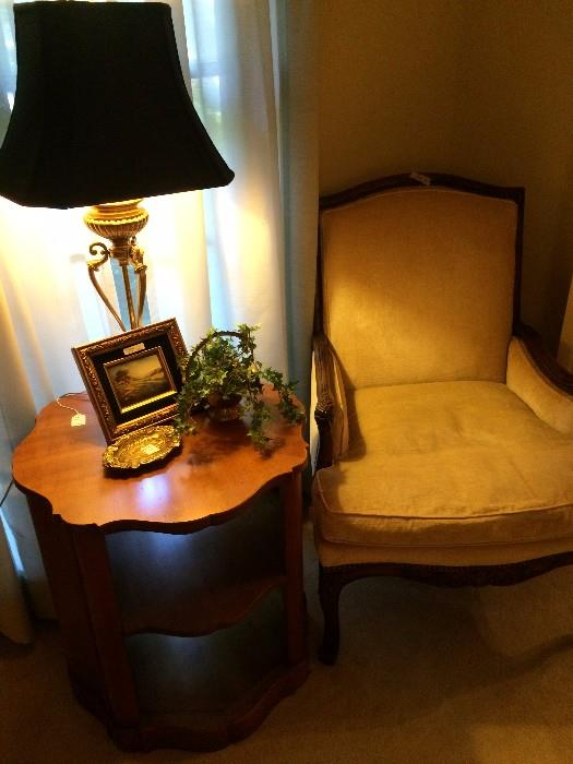 Formal chair has matching sofa; 3 tiered side table