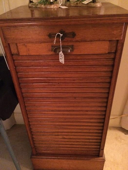Antique music cabinet (rolls from bottom to top)