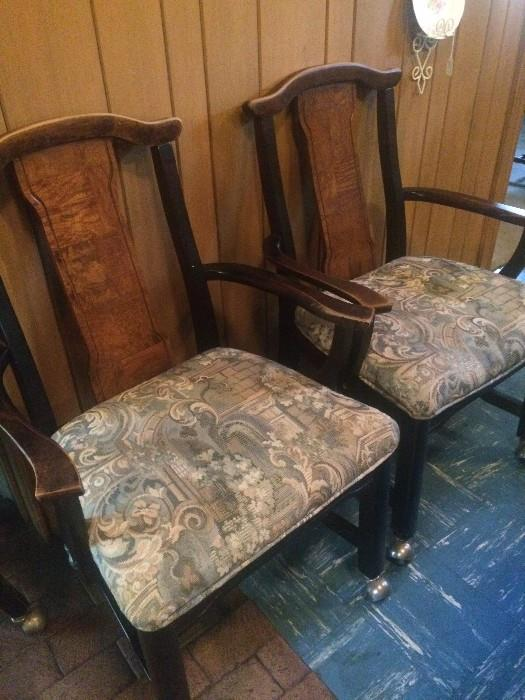 Two of four matching chairs  with arms and rollers