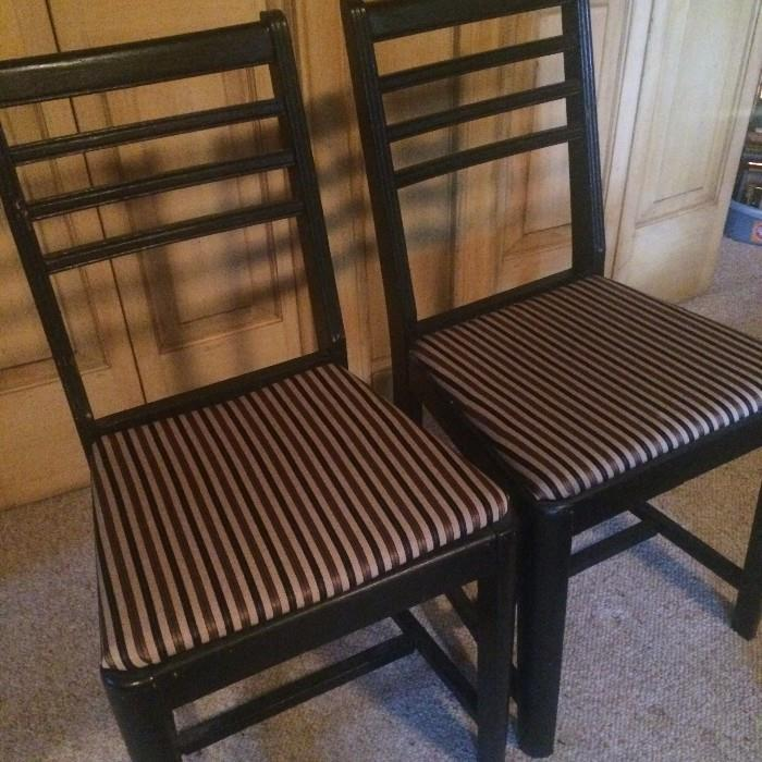 Two of four matching black chairs