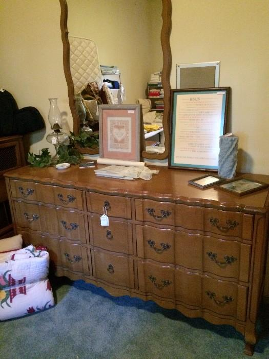 Provincial triple dresser has matching bed and nightstand