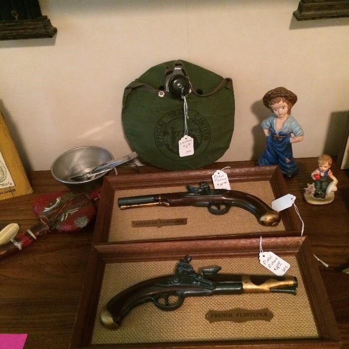 Framed pistol models; canteen