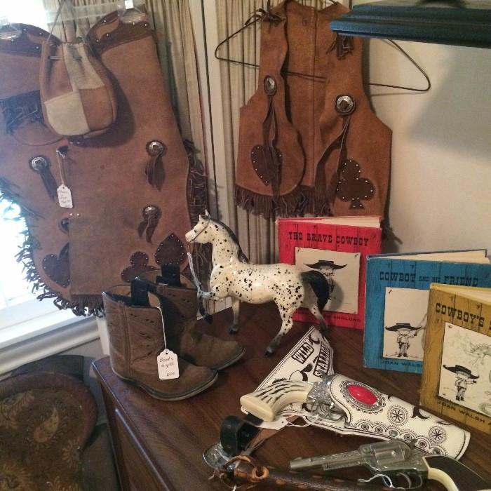 Vintage child's chaps, vest, boots, and toy guns