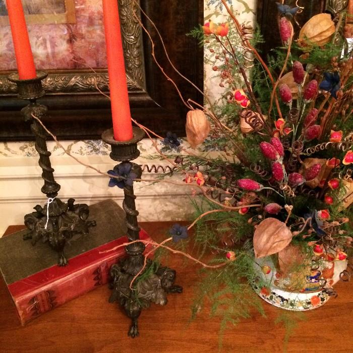 Very old candle holders and floral arrangement