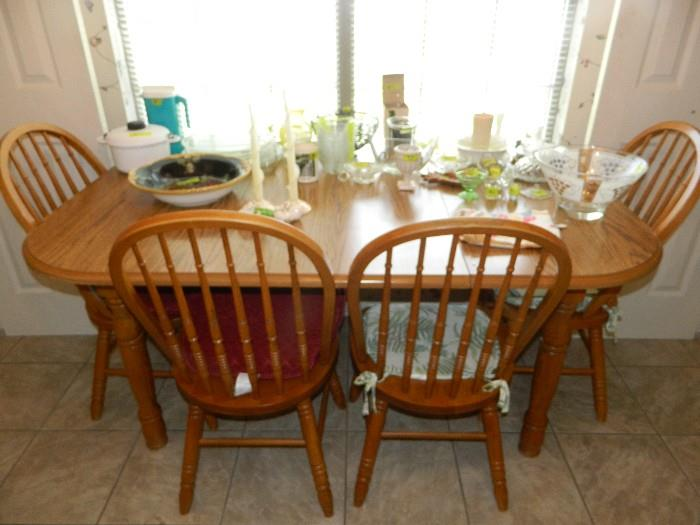 Oak Table and 4 chairs.  Various glass, plastic items, and kitchen items
