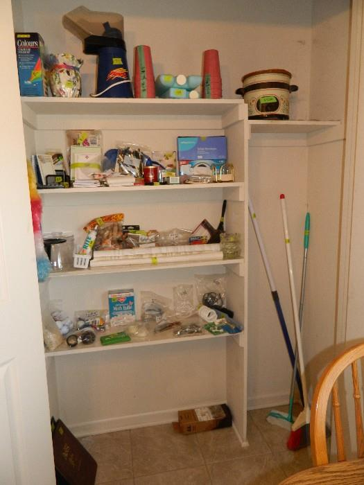 Kitchen:  Miscellaneous items from throughout the house as well as cleaning items; crock pot