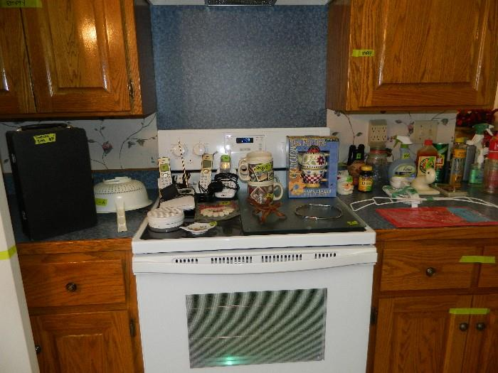 Portable bar, phones, candles, cleaning supplies, various jars, weather radio, smoke alarm, and carbon dioxide monitor