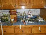 More candles, baskets, kitchen utensils, knives, various other items