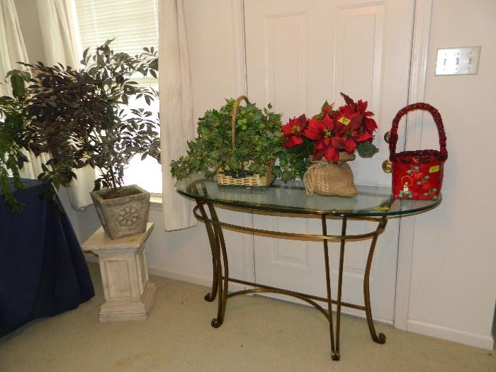 Entryway metal table with heavy glass top, pedestal, flower arrangements