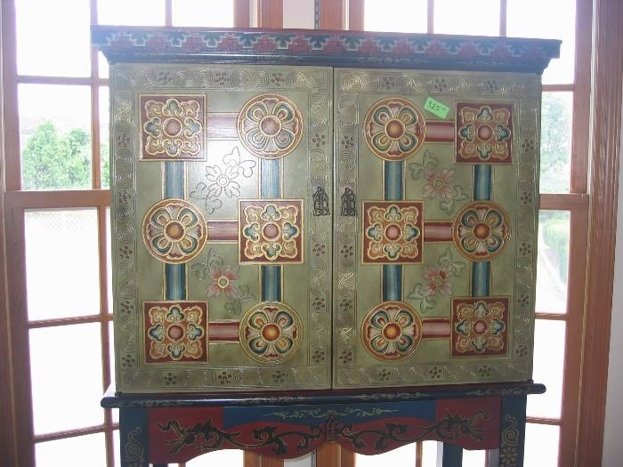 Chinese two door writing desk with small pull-out for writing.