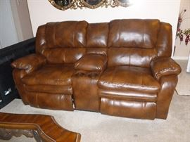 Leather sofa with electric recliners & massage