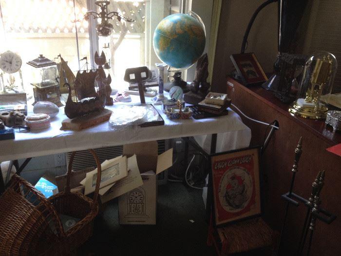Jere style brass art, antique view finder, antique globe, clocks,
