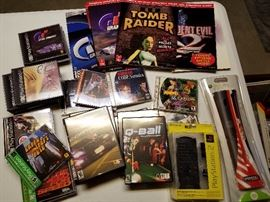 Assorted video games and strategy books for saga, PlayStation and Xbox.