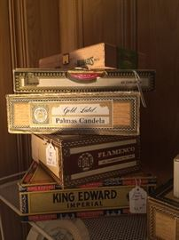 Approximately 30  cigar boxes