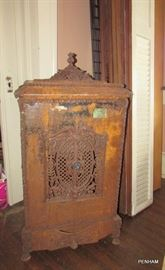 Very old iron Holland wood heater.