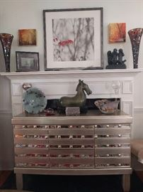 Very nice mirrored/silver-leafed buffet, that matched the dining table.                                                                         Above the mantle, a nicely framed/matted print, by Atlanta artist, Marilyn Suriani.  http://www.surianiphoto.com/