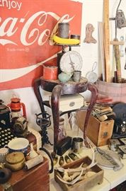 Enjoy Coca-Cola Metal Sign, Vintage Food Scale, Stool, Tins, Cast Iron Clawfoot, Jewelry Box, Barrel, Meter Sticks, Antique Bean Planter, Lantern, L.C. Smith Typewrite no. 8, Antlers, Wooden Drawers, Wooden Hangers, Cow Bell