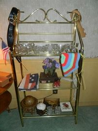 Goldtone metal Baker's Rack, Gun holster, glassware, various collectibles