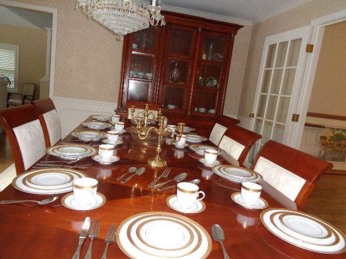 Baker dining room set with 12 place setting Noritake china and yakima 10 place setting flatware set.