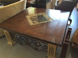 Heavy metal base, leather topped table