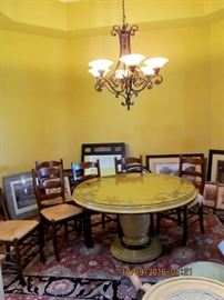 Fabulous pedestal table by Woodland Furniture of Idaho Falls of Idaho  (was $4000 new!) Comes with or without 6 wicker chairs, a large oriental carpet and the wrought iron chandelier seen hanging above all sold as a group or individually.