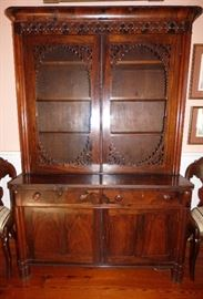 Rosewood glass front bookcase/cabinet.  Look at the grain in the doors & the decoration around the glass doors!
