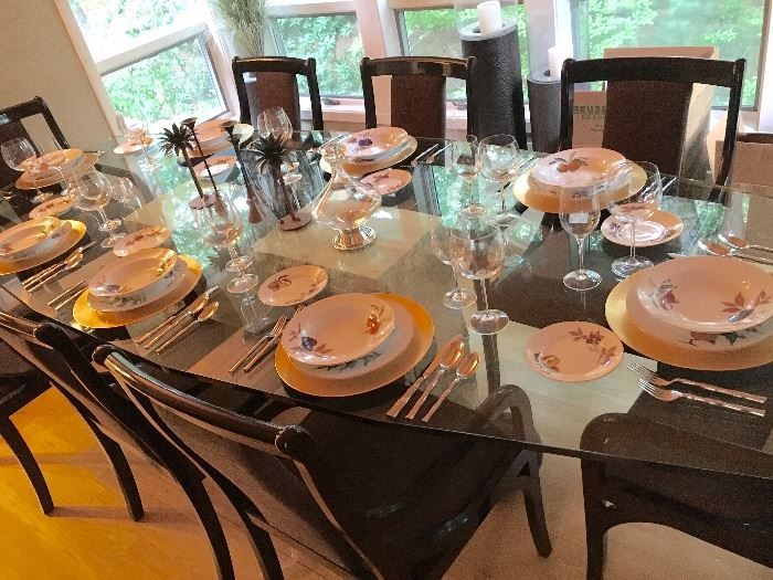 Elegant glass top dining room table with chairs