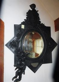 great ebonized cherub ,knight mirror