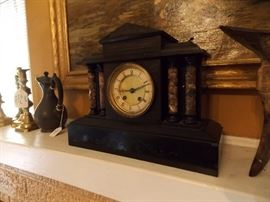 Extremely heavy, antique 19c, black basalt, columned mantle clock.