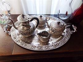Heavily repoussed silver plate tea set and matching tray.