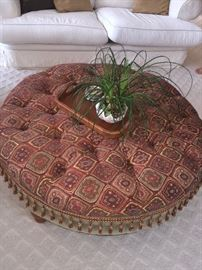TUFTED OTTOMAN WITH TASSELS