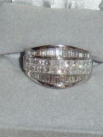 Platinum and Diamonds w/ 24 Pincess Cut Diamonds Weighing 2.48CTW & 30 Baguette Diamonds Weighing 1.54CTW