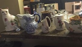 Pitchers, teapots, and don't forget the cat