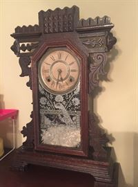 Vintage clock with peacock on glass