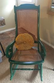 Green and wicker rocking chair