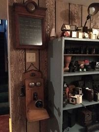 Handsome oak wall telephone and antique bell call box next to vintage small clocks  and cameras!