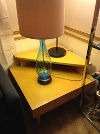 Blown glass in blue atop a Mid Century corner step table!