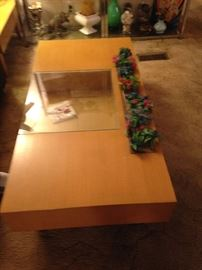 Matching coffee table with glass insert and built in planter. Also has a drawer on either side of glass with Black fronts.