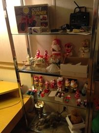 One of two matching chrome and glass etagere displayed with some vintage Christmas items!