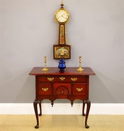 "18th c American Mahogany lowboy w/carved fan, Banjo clock w/original ""Perry's Victory"" eglomise glasses, 18th c Candlesticks, Cobalt Blue covered sugar"