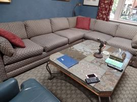 Large sectional sofa. One more armless piece too. Coffee table and items on top not for sale