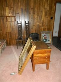 Chairs, framed art, empty frames, side table with pull out trays